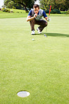 Man assessing his options to putt