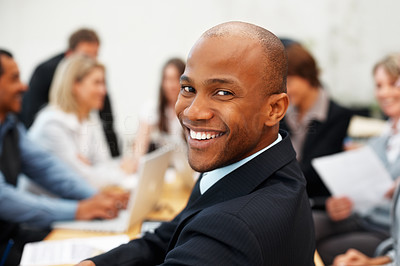 Buy stock photo Happy businessman with colleagues having meeting in background