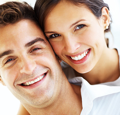 Buy stock photo Closeup portrait of an attractive young couple smiling together