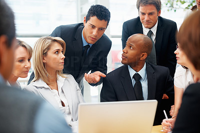 Buy stock photo Executive explaining while colleagues listen during meeting