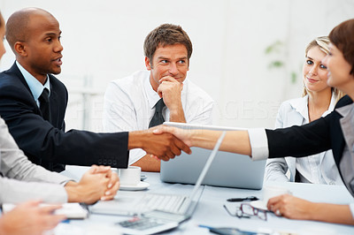 Buy stock photo Executives shaking hands during meeting