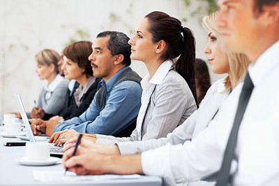 Buy stock photo Attentive executives listening to speaker during meeting