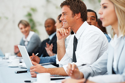 Buy stock photo Focus on smiling executive during business meeting