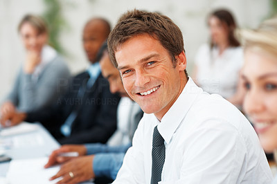 Buy stock photo Closeup of business man smiling during meeting