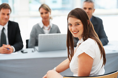 Buy stock photo Portrait of woman smiling with panel of interviewers in background