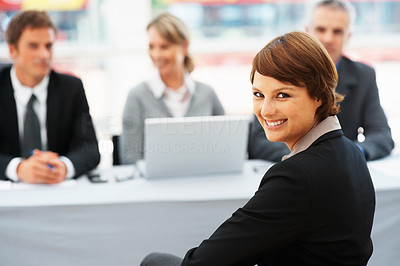 Buy stock photo Portrait of cute woman smiling with panel of interviewers in background