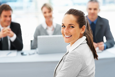 Buy stock photo Portrait of beautiful woman giving a cute smile with panel of interviewers in background