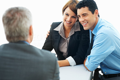 Buy stock photo Focus of business couple in conversation with mature executive