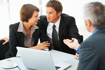 Buy stock photo Focus on business couple looking at each other during business meeting