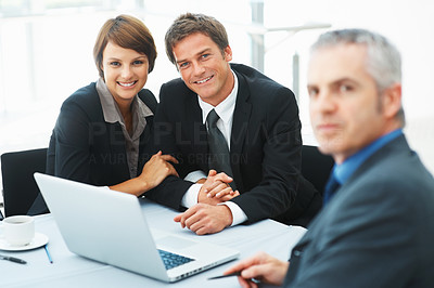 Buy stock photo Focus on business couple in a meeting