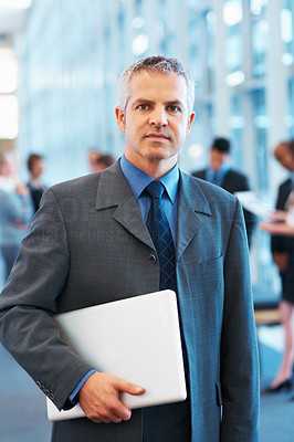 Buy stock photo Portrait of mature business man carrying a laptop