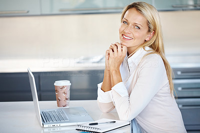 Buy stock photo Portrait of a happy young businesswoman with a laptop at her desk in office
