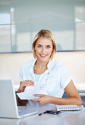 Buy stock photo Portrait of a cute young businesswoman with a laptop working at her desk