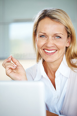 Buy stock photo Portrait of an attractive young businesswoman looking happy at office