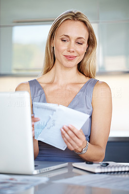 Buy stock photo Portrait of a pretty young lady holding an envlope while working at office - Indoor