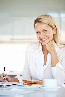 Buy stock photo Portrait of a happy young woman doing some paperwork while having breakfast - Indoor