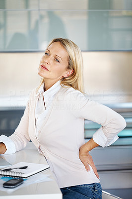 Buy stock photo Portrait of successful mature business woman with pain in lower back