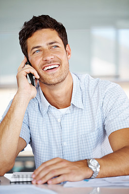 Buy stock photo Portrait of a handsome young man talking on mobile phone in office