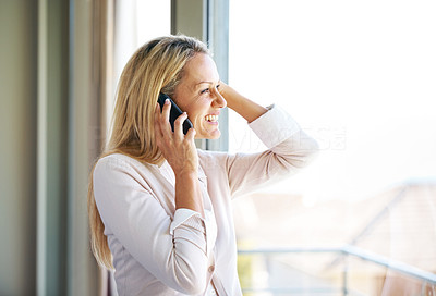 Buy stock photo Portrait of a cute young lady using a cellphone by the window