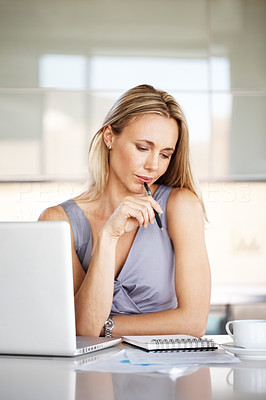 Buy stock photo Portrait of a thoughtful young business woman taking notes at office