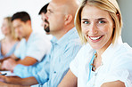 Young business woman smiling with colleagues at back
