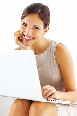 Buy stock photo Portrait of pretty young woman sitting with laptop and smiling