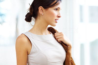 Buy stock photo Closeup of pretty young female with handbag looking away