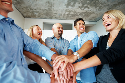 Buy stock photo Smiling business colleagues with their hands together - Gesturing unity
