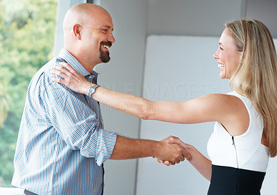 Buy stock photo Portrait of a happy young businesswoman congratulating a colleague at office