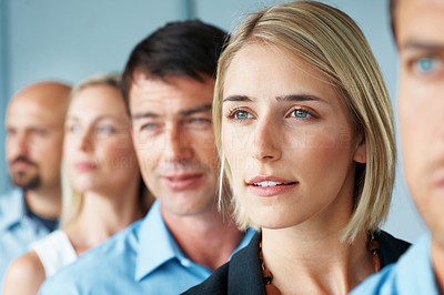 Buy stock photo Portrait of a five business people standing in a row and looking away