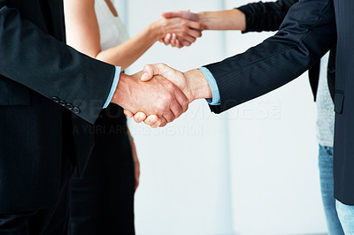 Buy stock photo Mid section image of business people shaking hands after a meeting