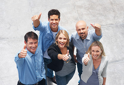 Buy stock photo Portrait of smiling group of business people showing you a success sign