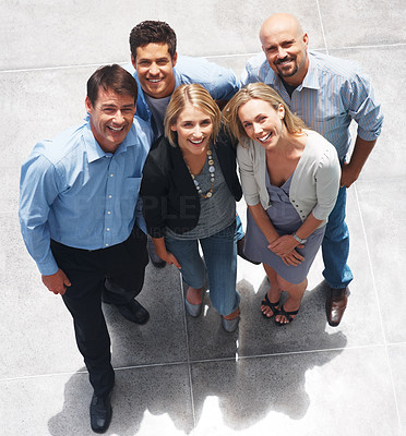 Buy stock photo Top view of happy group of business people standing together and smiling
