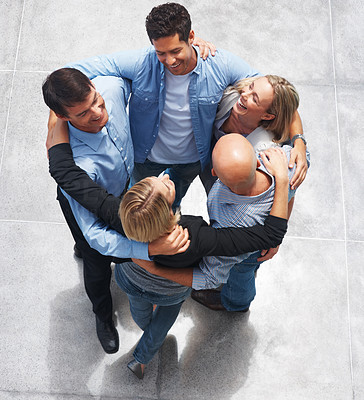Buy stock photo Top view of successful and confident business people forming a huddle