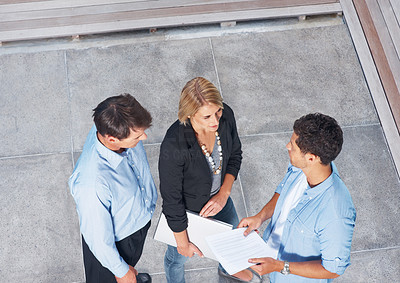 Buy stock photo Top view of professional businesspeople standing and discussing business issues
