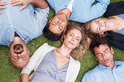 Buy stock photo Small group of people lying together on grass and sleeping