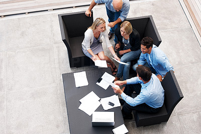 Buy stock photo Top view of businesspeople sitting together and discussing on new business project