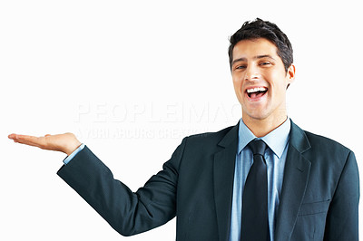Buy stock photo Happy business man showing something on the palm of his hand