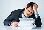 Businessman sitting behind paperwork