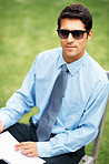 Executive wearing sunglasses outdoors