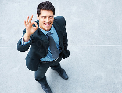 Buy stock photo View of executive giving okay sign outside