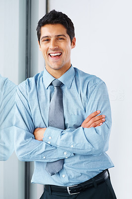 Buy stock photo Cheerful business man leaning against window with arms folded