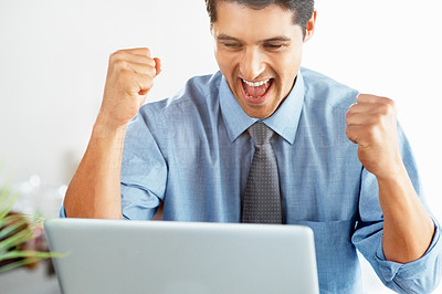 Buy stock photo Executive holding his fists in excitement while looking at laptop