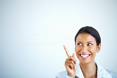 Buy stock photo Happy female executive pointing at copyspace