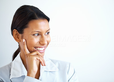 Buy stock photo View of business woman with hand on face looking into distance