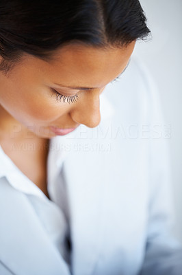 Buy stock photo Closeup of businesswoman looking down