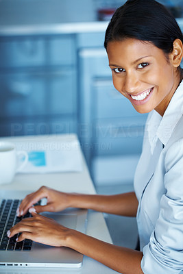 Buy stock photo View of business woman working on laptop at desk