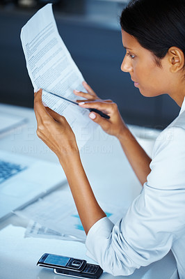 Buy stock photo Side view of business woman reviewing contract