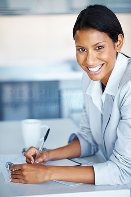 Buy stock photo Pretty business woman sitting at table with notebook