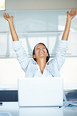 Buy stock photo View of woman at desk with arms thrown up and eyes closed